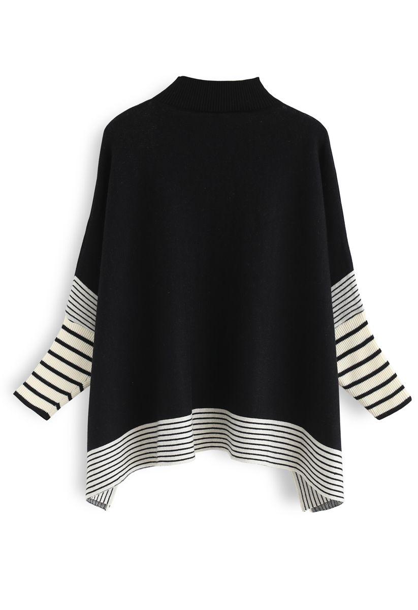 Acuéstate en el suéter de punto de rayas extragrandes de los campos negros