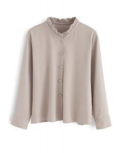 Añadir una pequeña camisa de volantes en rosa polvoriento