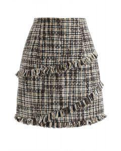 Minifalda de brote de tweed con borlas